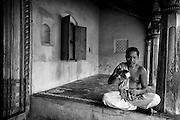 Mr. K. Sethumadhavan has a morning tea seated on the thinnai of his home.  Door No: 74 Subramanium Baradiya Street. Entrance to a family home in Karaikal. Puducherry.