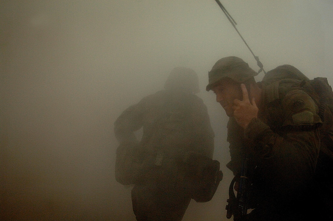 With the help of smoke, Australian soldiers gain entrance to the city. — © Tsgt Jeremy Lock/