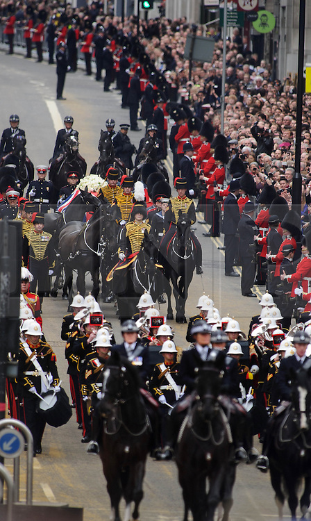 © Licensed to London News Pictures. 17.04.13 London, UK. Former British Prime Minister Margaret Thatcher's funeral procession makes it's way along Fleet Street to a service at St Paul's Cathedral, London..Photo credit : Simon Jacobs/LNP