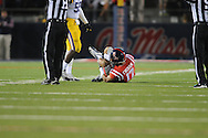 Mississippi tight end Evan Engram (17) grabs his ankle after being injured vs. LSU at Vaught-Hemingway Stadium in Oxford, Miss. on Saturday, October 19, 2013. Mississippi won 27-24. (AP Photo/Oxford Eagle, Bruce Newman)