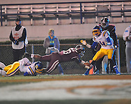 Picayune's Earl Nastasi scors over Oxford High's D.K. Hutchins (20) and Oxford High's K.T. McCollin (4) in the MHSAA Class 5A championship game at Mississippi Veterans Memorial Stadium in Jackson, Miss. on Saturday, December 7, 2013.