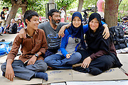 Zahra (17) (blue scarf) with her family. They used to live in Kabul where her father was a Shia priest who the Taliban didn&rsquo;t like and she was going to high school with high interest in mathematics that she would like to study. Her mother was a seamstress and she also has two brothers of which we can see the younger. They all left Kabul in order to protect her as they were informed by a letter that a week later she would be taken by the Taliban. One of her neighbourhood friends had already been taken by the Taliban and nobody knew what happened to her, an other one of her friends had been killed in a suicide bombing and she was very scared. She is hoping that the family can reach a country where they can sleep without fear and where she will not create any more bad memories.<br /> Victoria square in Athens is one of the main gathering places for refugees. They stay there until they can find a way to travel to Thessaloniki and to the northern border of Greece where they can cross on foot on their way to northern European countries.