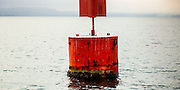 Detailed abstract view of a port navigation buoy off Motuihe Island