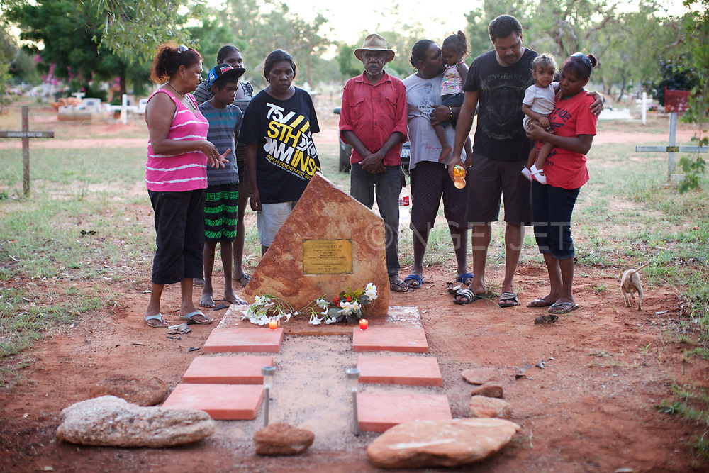Lorna Kelly Cox (L) and family cleaned the grave of her mother. Lorna was taken from her parents when she was six years old but the family she went to returned her to her mother two years later, only to be removed from her parents again by the social services and police. Broome, WA