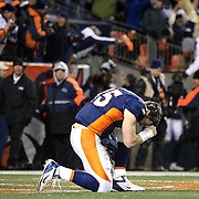 SHOT 1/8/12 7:08:42 PM - The Denver Broncos Tim Tebow #15 takes knee to pray in the endzone after beating the Pittsburgh Steelers during their AFC Wildcard game at Sports Authority Field at Mile High on Sunday January 8, 2012. The Broncos won the game in overtime 29-23 on the first play. Tebow threw a pass to teammate Demaryius Thomas who took it 80 yards for the touchdown. (Photo by Marc Piscotty / © 2012)
