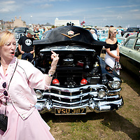 &quot;Its proper massive, innit?!&quot;<br /> A Teddy Girl checks out the Caddy.