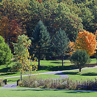 New England walk in the park at Green Hill Park in Worcester, MA featuring fall colors on a beautiful October picture perfect autumn day. Fall foliage showing their stunning display along the banks of Green Hill Pond. The urban greenspace provides local recreation and is located atop one of Worcester's seven main hills. The public park is home to the Massachusetts Vietnam Veterans' Memorial. Green Hill Park photos are available as museum quality photography prints, canvas prints, acrylic prints or metal prints. Prints may be framed and matted to the individual liking and room decor needs:<br />