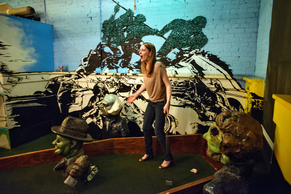 Photo by Matt Roth.Assignment ID: 10137081A..Kathleen Hudik reacts after her golf ball rests at the lip of the dead president themed hole upstairs at H Street Country Club where patrons can play mini golf on a D.C. themed course while they grab a drink in Washington, D.C. on Saturday, January 12, 2013...H Street, N.E, in Washington D.C. was recently ranked sixth on Forbes magazine's list of the nation's best hipster neighborhoods.