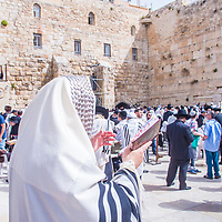 JERUSALEM - APRIL 13 : Orthodox jewish men prays in The western wall during Passover on April 13 2017 , The Western wall is important Jewish religious site located in the Old City of Jerusalem