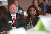 Keynote speaker, Anika R. Khan (right(, Vice President and Economist, Wells Fargo  and Joe Kirk, Regional President for Wells Fargo New York and Connecticut (left) listen to the panel discussion at the Manhattan Chamber of Commerce Annual Economic Outlook Breakfast was held at the New York Athletic Club in New York on April 4, 2011. The breakfast was sponsored by Wells Fargo.
