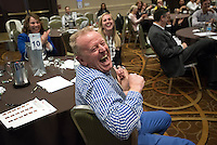 Conference attendees share a laugh.