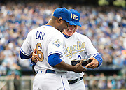 KANSAS CITY, MO - APRIL 5, 2016: Lorenzo Cain #6 of the Kansas City Royals receives his 2015 World Series Championship ring from Manager Ned Yost #3 during pre-game ceremonies before the game between the New York Mets and the Kansas City Royals at Kauffman Stadium on April 5, 2016 in Kansas City, Missouri. (Photo by Jean Fruth)