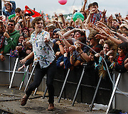 Ed Macfarlane of Friendly Fires performs live on the Main Stage during day three of Reading Festival 2011 on August 28, 2011 in Reading, England.  (Photo by Simone Joyner)