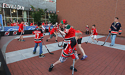 May 25, 2012; Newark, NJ, USA; Young New Jersey Devils and New York Rangers fans play hockey before game six of the 2012 Eastern Conference finals at the Prudential Center.