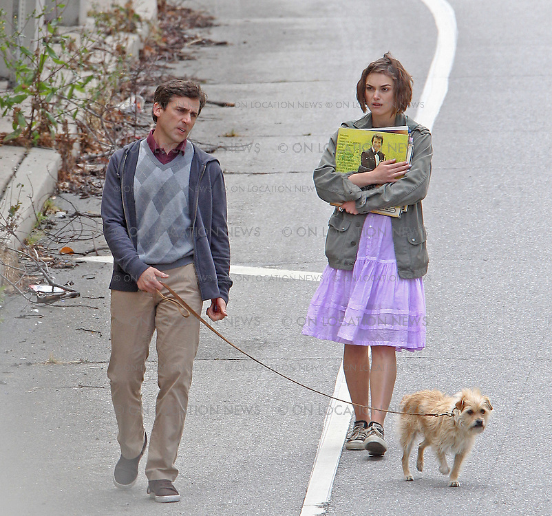 """***EXCLUSIVE***Steve Carell, Keira Knightley and a dog with the character name """"Sorry"""" film a scene for """"Seeking a Friend for the End of the World"""". In this scene, the trio walk down the street trying to hitch a ride. As  Knightley carries some vinyl record albums, Carell pulls out a letter as they argue about something. Knightley manages to flag down a truck driver who is played by former """"CSI"""" lead actor William Peterson. On set the previous day, Carell & Knightley filmed a scene in which they shot the truck driver and buried him in a field but accidentley also buried the truck's keys in the proccess. May 18th, 2011  Los Angeles, CA.  Photo by Eric Ford/ On Location News 818-613-3955  info@onlocationnews.com"""
