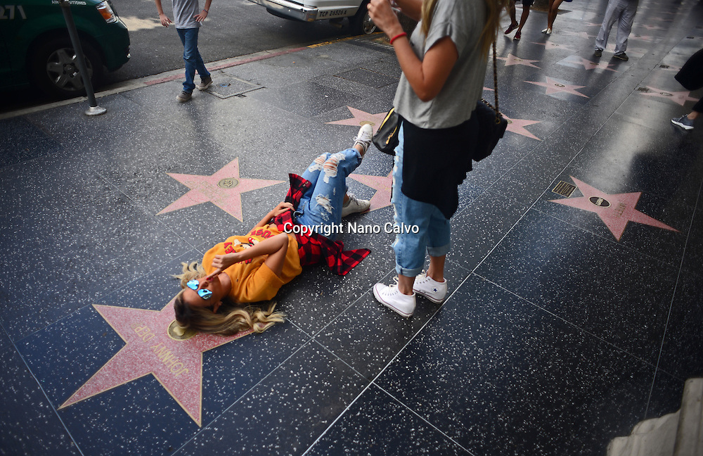 Young girl posing next to Johnny Depp´s star at Hollywood Walk of Fame, Los Angeles, California.