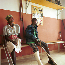 Angolans wait to see a doctor at the International Red Cross hospital in Huambo, Angola. Hundreds of thousands of Angolans  have lost limbs after stepping on a mine and in some towns one-in-four people have lost a limb or have been killed by mines. Despite a huge campaign to educate Angolans of the danger, most are forced to search the countryside for food despite the risk..(Photo by Ami Vitale)