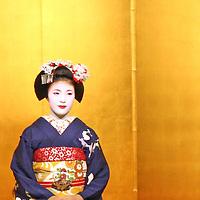 Asia, Japan, Kyoto. Sitting Geisha in traditional kimono.