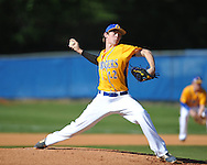 Oxford High's Houston Roth (12) pitches vs. Jackson Callaway in MHSAA Class 5A playoff action in Oxford, Miss. on Friday, April 25, 2014.