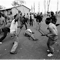 IPMG0039 South Africa, Soweto, 1990..Inkatha supporters beat a non-Inkatha Freedom Party man they said shot at them during the 'ethnic cleansing' of the migrant workers' hostels, Nancefield, Soweto, 17 August, 1990.  Thousands of people, both civilians and combatants died in the so-called Hostel War from 1989-1995..Photograph by Greg Marinovich/South Photographs