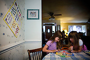 Vivian, left, and Bea Ferrell play a board game at their home in Lincoln, CA May 13, 2009.