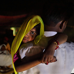Rajni Bhamwari, 5, is seen just after waking up before her wedding ceremony in Rajasthan, India on April 28, 2009.
