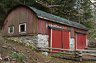 This barrel-roof shed  was built (between 1900 and 1910) by Richard Maxwell on his farm near Burgoyne Bay on Salt Spring Island, British Columbia, Canada.  The farm land is now part of Burgoyne Bay Provincial Park.  This shed was built for storage of larger farm equipment and has two, large access doors on the roadside of the building.  Photographed from Burgoyne Bay Road.
