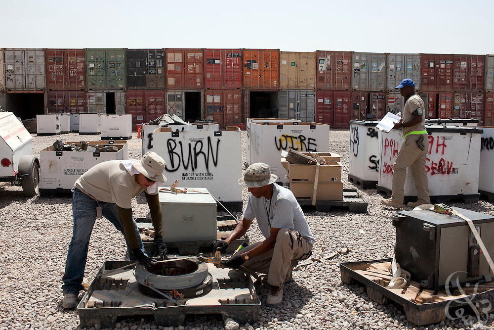 "Equipment and supplies from U.S. bases across the Iraqi theater are sorted by type into containers as part of Operation Clean Sweep by The U.S. Army's 103rd Expeditionary Sustainment Command at Joint Base Balad August 27, 2010.  As part of the ongoing operation, excess and surplus items from U.S. bases In Iraq are sorted for redeployment to Afghanistan and the USA , repair, or disposal by various methods as part of what is being described as the ""responsible drawdown"" of U.S. Forces in Iraq.   .Slug: Iraq"