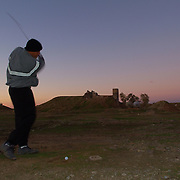 Dec 12th 2003....Quyarra, Mosul, Iraq.....US Army Golf Course.....Major Spence Smith takes a practice swing on a 6 hole golf course built at the base of 101st Aibourne 50 kms south of Mosul. It is by location perhaps the most hositle course in the world and reckoned to be Iraqs first and only.