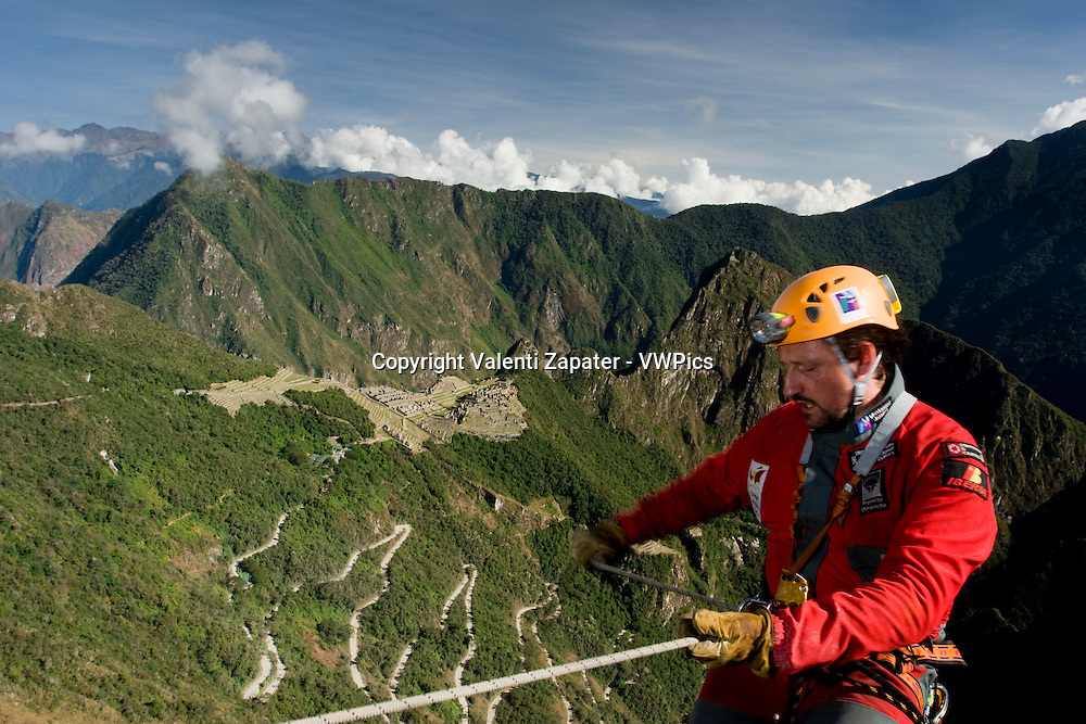 Ukhupacha team rapelling and exploring near Machupicchu. Cusco, Peru