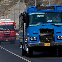 buses passing across the venezuelan major bridge called viaduct #1. This bridge is the key route to the country's main airport in Venezuela. Feb 27 2008. (ivan gonzalez).