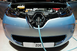 Detail of Renault Zoe electric car with plu-in charging cable attached at Paris Motor Show 2012