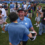 North Carolina Head Coach JOE BRESCHI, right, celebrates with staff after North Carolina defeated Maryland 14-13 in overtime during The NCAA Division I NATIONAL CHAMPIONSHIP GAME between North Carolina and Maryland, Monday, May. 30, 2016 at Lincoln Financial Field in Philadelphia, Pa