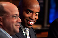 """Former New York Giants running back Tiki Barber listens as NBC President and CEO Jeff Zucker(L) speaks to members of the media as he is introduced as a news correspondent for NBC's """"The Today Show"""" in New York, February 13, 2007. Barber will also be a sports analysts for NBC's """"Football Night in America""""."""