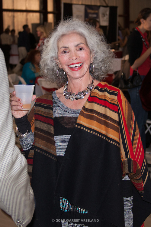 Best smile of the evening. Stylish attendee, Planes and Cars at the Santa Fe Airport, 2013 Santa Fe Concorso.