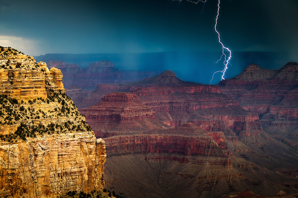 Lightning strikes behind a ridge near Claude Birdseye Point at Grand Canyon National Park.