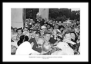 President John F. Kennedy is mobbed by well-wishers and photographers at a garden party at &aacute;ras an Uachtar&aacute;in.<br />