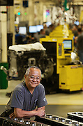 Volvo Factory worker getting ready to assemble a truck engine