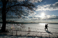 Boston, MA - Walkers make their way along the beach off Day Boulevard in South Boston on a frigid Sunday, January 23, 2011.  Frigid weather is expected in the region over the next few days.   Photo by Matthew Healey