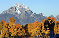 Michael Hardeman uses an 8x10 format camera to snap a photograph of Mt. Moran at sunrise.