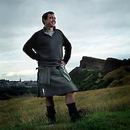 London stockbroker and Scot Roger Kennedy wearing a kilt from 21st Century Kilts, in Edinburgh's Holyrood Park, Scotland, UK.