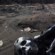 """Charred remains seen on the ground  in Onicha Amiyi-Uhu in Abia state, eastern Nigeria, Sunday, June 22, 2003. Fuel gushing from a vandalized pipeline exploded, killing at least 105 villagers in the rural north eastern Nigeria as they scavenged gasoline. Pipeline vandalism or """"scooping"""" is common in Nigeria despite the risk of fire, prosecution or being shot on sight by security forces. (Photo/George Osodi)"""