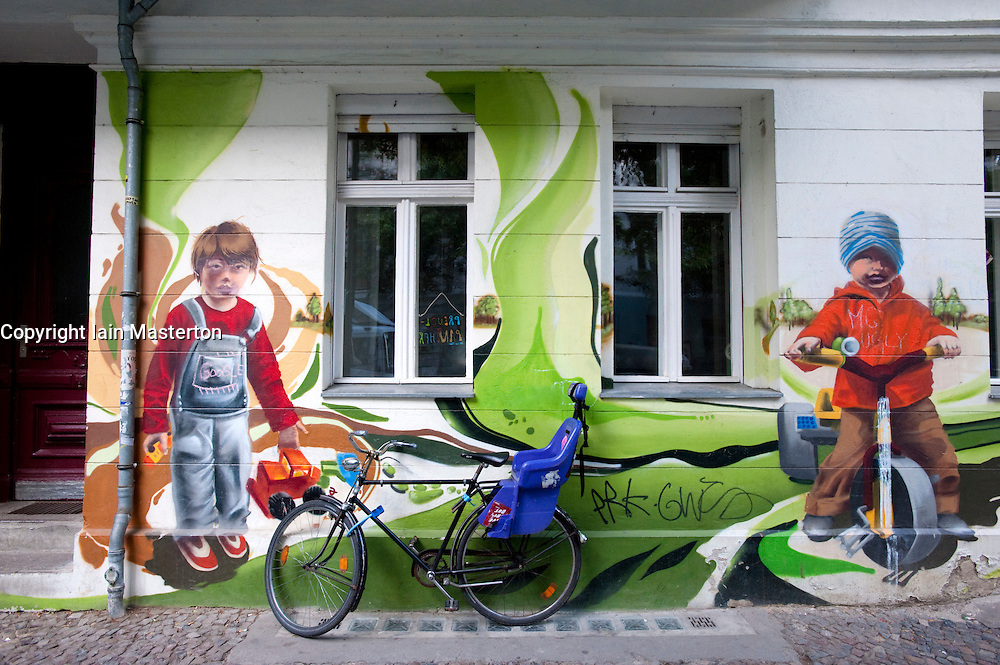 mural of children playing painted on outside wall of kindergarten in prenzlauer berg in berlin. Black Bedroom Furniture Sets. Home Design Ideas