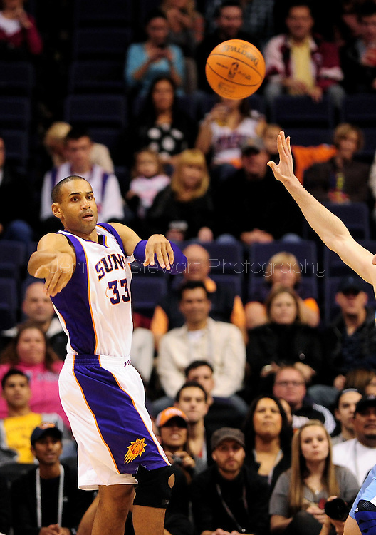 Dec. 22, 2011; Phoenix, AZ, USA; Phoenix Suns small forward Grant Hill (33) makes a pass against the Denver Nuggets during the first half of a preseason game at the US Airways Center. The Nuggets defeated the Suns 110-85. Mandatory Credit: Jennifer Stewart-US PRESSWIRE.