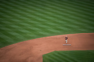 A lone member of the grounds crew places finishing touches on the infield during opening day at Oriole Park at Camden Yards in Baltimore, Monday, April 4, 2016.  The Baltimore Orioles defeated the Minnesota Twins 3-2.