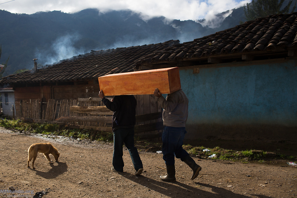 Family members carry a coffin with the human remains of Jacinta Solis de Leon, who starved to death in the mountainside in 1982 while fleeing from State-led repression. The remains, exhumed by members of the Forensic Anthropology Foundation of Guatemala (FAFG) in 2013, were identified using DNA analysis and buried 35 years after Ms. Solis de Leon's death. Acul, Nebaj, Quiché, Guatemala. February 3, 2017.