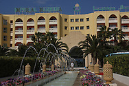 Scenes from Tunisia's resort area, El Kantouai, Imperial Marhab Resort entrance with fountains and flowerbeds