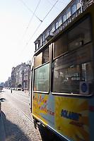 tram arrives in krakow old town on ulica pilsudskiego on sunny afternoon in september 2005
