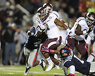 Texas A&M running back Ben Malena (1) is chased by Ole Miss linebacker Denzel Nkemdiche (4) and Ole Miss defensive back Dehendret Collins (1) in Oxford, Miss. on Saturday, October 6, 2012. Texas A&M won 30-27...