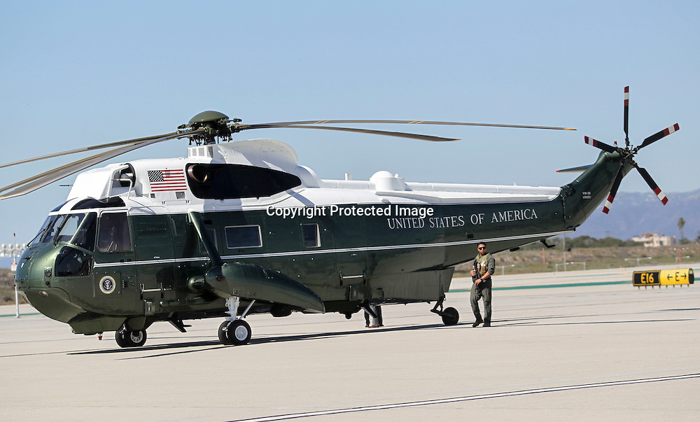 A security personnel stands guard next to the Marine One before President Barack Obama's arrival at Los Angeles International Airport in Los Angeles on Saturday, Oct. 10, 2015. (AP Photo/Ringo H.W. Chiu)